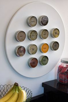 And magnetic spice tins makes everything easy to see without the bulk of a spice rack. | 24 Clever Ways To Get Organized From Etsy