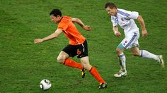 DURBAN, SOUTH AFRICA - JUNE 28: Juraj Kucka of Slovakia pursues Mark Van Bommel of the Netherlands during the 2010 FIFA World Cup South Africa Round of Sixteen match between Netherlands and Slovakia at Durban Stadium on June 28, 2010 in Durban, South Africa. (Photo by Steve Haag/Getty Images)