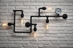 Industrial, Upcycled pipes wall lamps are trending right across the globe, get some cool lighting for your home and office. Call our vintage light store 01780 435060 Pipe Lighting, Cool Lighting, Kitchen Lighting, Industrial Wall Lights, Industrial Pipe, Lamp Inspiration, Disco Lights, Retail Store Design, Pipe Lamp