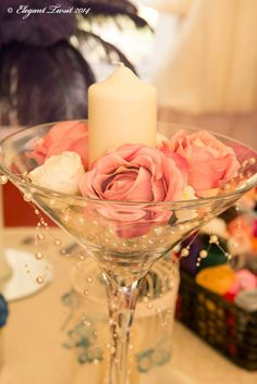 Martini glass, candle and flowers