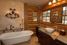great black cabinets and clawfoot bathtub in rustic bathroom idea feat wooden bay window | Rustic Bathroom Ideas Present Elegant Bathroom  | https://www.designoursign.com #bathroom  #luxurybathroom #luxurybathroomideas #luxuryfurniture #interiordesign #luxurydesign #homedecor #designdetails #rusticbathroom