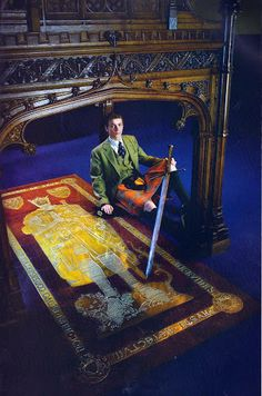 The Master of Bruce - The eldest son of the eldest son of the Earl of Elgin, the Hon. James Bruce, holds the 14th-centtury sword of Robert the Bruce by the King's tomb in Dunfermline Abbey. The brass effigy of 1889  is set in a great slab of porphryy, reputedly from the tomb of Constantine I, given to the 7th Earl by Ottoman Sultan Selim III, and brought to Scotland in 1802.