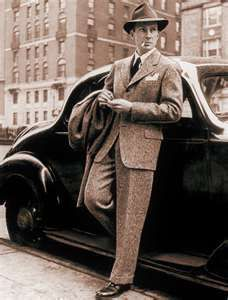 1940's Fashion |  Men's fashion in the 1940s    consisted of an oversized jacket, wide lapels, broad shoulders, low crotches, and the pants narrowed toward the ankles.""