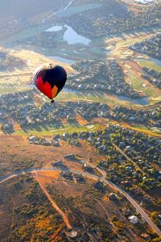 Park City in the summer looks unbelievable from high in the sky! Be sure to book a hot air balloon ride when you're visiting a Park City vacation rental.