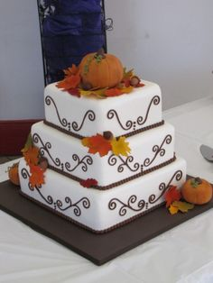 Fall Wedding Cake- I like the leaves, but not excited about the pumpkins