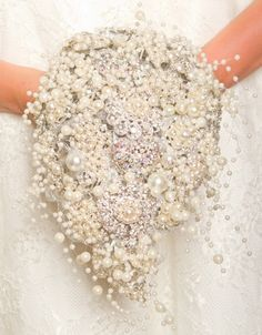 source What's not to love about some sparkle? We are huge fans of the brooch bouquet trend and you should be too. These bouquets are glam yet romantic and perrrrfect Flower Table Decorations, Flower Centerpieces, Wedding Centerpieces, Table Centerpieces, Wedding Decorations, Pearl Bouquet, Bridal Brooch Bouquet, Broschen Bouquets, Wedding Bouquets