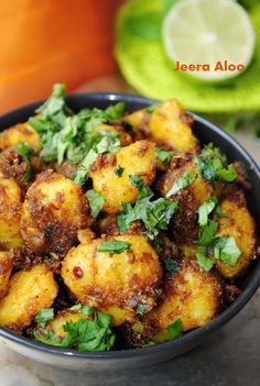 Stir Fried Potatoes with Roasted Cumin, Chili Power, and Cilantro.