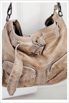 Soft natural leather bag featuring shoulder strap, belt detail and front pockets from Pure Love.