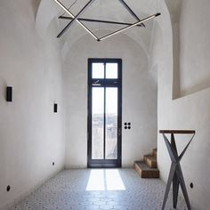 In transforming a 16th century-Czech Republic residence into this guesthouse local studio ORA celebrated an assortment of original details including old plasterwork semi-circular windows and stone steps. Find out more on dezeen.com/interiors #interiors #rustic #renovation #house Photograph by @boysplaynice. - Architecture and Home Decor - Bedroom - Bathroom - Kitchen And Living Room Interior Design Decorating Ideas - #architecture #design #interiordesign #homedesign #architect #architectural…
