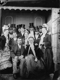 A formally attired group of Victorians (love the sea of top hats!). #portrait #Victorian #wedding #1800s