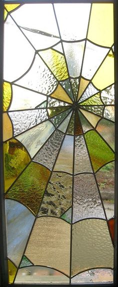 Stained glass spider web by Kay Schumacher