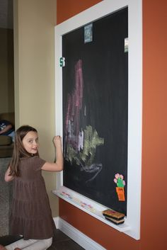 Magnetic Chalkboard.  I first painted magnetic paint in the designated square, then chalkboard paint on top of that.  Jeff made the frame and chalk/eraser tray.  I painted frame and tray separately, then Jeff put them together.  One more coat of paint once on the wall, and voila!!  (Thought about using whiteboard paint too, it would be less dusty when in use... but magnetic paint is BLACK!)