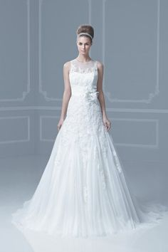 """""""Fargo""""  A-line tulle and lace gown with a sheer neckline. Ruching belt with flower design at empire waist."""