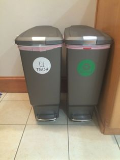 Matching simple human trash cans, with stickers from ETSY. My new trash and recycling setup. I am so relieved I don't have to look at the ugly, dirty trash can and paper bag anymore!!