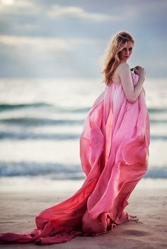 Billowy dress on the beach. Oh me, oh my!