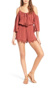 647ada809fb2 Showing off sun-kissed shoulders in this beautifully breezy romper trimmed  with a tassel-