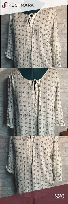 """Tie front V-neck Tunic White and Black V-neck , tie front Tunic. 100% rayon, 3/4 sleeve, size Large. Bust 19"""", length 26"""". Tops Tunics"""
