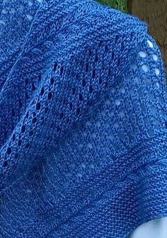 Free knitting pattern for Braid and Eyelet Shawl. Susan Gressman's asymmetrical shawl features a garter stitch and cable braid which alternates with sections of simple eyelet.