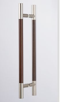 """DH401/BB - Stunning leather door handles! Inspired by their smaller drawer pull counterparts, this extremely popular design has expanded into a new larger size making for some strikingly elegant door pulls. Easy grip and leverage with ¾"""" diameter rod. Sold as a set of 2. Back to back mounting hardware included. Colors: Nickel with Black, Chestnut Brown or Chocolate Brown leather."""