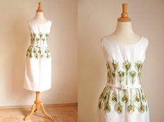Vintage 1960s Peacock Dress // 1960s Wiggle Dress // Rare Novelty Dress // Peacock Feathers. $225.00, via Etsy.