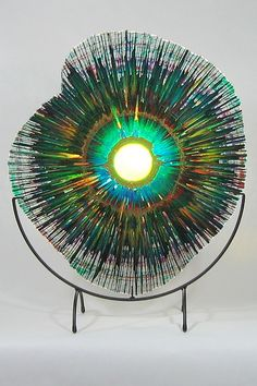 Splatter- EnergyWebs integrate the transparency of glass with beautiful splashes of color, and the element of motion. They are one-of-a-kind, unique creations of modern glass art. approx 18""