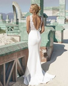 sheath wedding dress with a lace bodice and a plain skirt, with buttons on the back