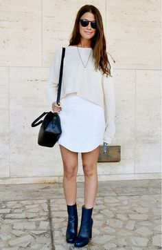 White crop top layered over white mini dress and black ankle boots