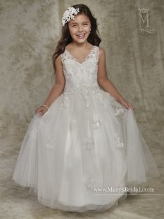Tulle flower girl ball gown with V-neck, V-back, sequined lace appliques, and back zipper closure.