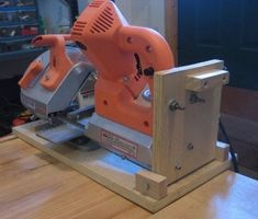 Homemade cutoff saw comprised of a portable bandsaw mounted on a hinged plywood base. Equipped with a drill press vise. Homemade Tube, Homemade Tools, Diy Tools, Sheet Metal Brake, Drill Press Vise, Portable Band Saw, Metal Working Tools, Wood Working, Homemade Tractor