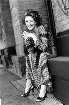 Julia Roberts. ° she has the most infectious laugh I love it!!!  And she is always smiling!! Just beautiful!!!