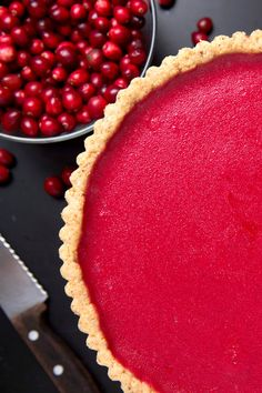 """NYT Cooking: If you are a fan of lemon curd or the classic French tarte au citron, you will love this cranberry version. To minimize kitchen time, make it in stages, preparing the crust and curd a day or two in advance. The finished tart keeps well for a couple of days too. The wheat-free hazelnut crust is adapted from a cookie recipe from the pastry chef and writer <a href=""""http://www.davidlebovitz.com/"""">David Lebovitz's popular website</a>."""