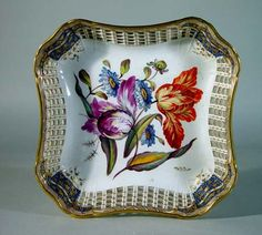 A Derby Openwork Botanical Dish Circa 1810-20  Decoration by Philip Clavey,  Circa 1810.   The openwork dish is decorated finely with flowers with two large tulips, one orange and red and the other purple and yellow. The gilding is possibly by Talkington, and the floral painting by Philip Clavey, who was a pupil of the renowned floral painter Quaker Pegg