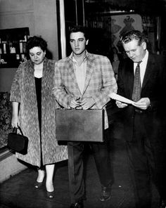 Elvis and his parents in the U-S army office in Memphis ready for his army induction in the morning of march 24th 1958.
