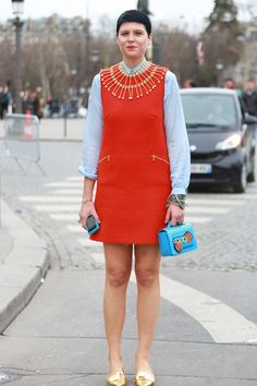 street style: Paris Fashion Week Fall 2014... Elisa Nalin's little red dress comes with built-in accessories.  Source: Tim Regas