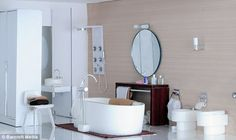 The chic bathroom has a modern shower, stylish bidet and large circular mirror that Elaine made by hand