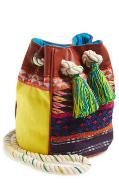 Free shipping and returns on HIPANEMA Crossbody Bucket Bag at Nordstrom.com. Bright tassels and shimmery metallic accents highlight the festive, geometric embroidery of an earthy, hand-crafted canvas bucket bag.
