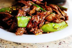 Stir fry beef with snow peas.