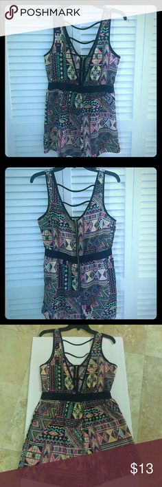 One piece romper from Charlotte Russe Beautiful Aztec prints brings this romper to life! Zip detail in the back and a deep strappy V-cut in the front. Perfect for summer! New without tags!! Charlotte Russe Pants Jumpsuits & Rompers