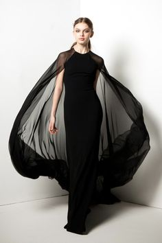 Black crepe gown with attached silk chiffon cape. From the Reem Akra capsule collection for Shopbop. Coming July 2015.