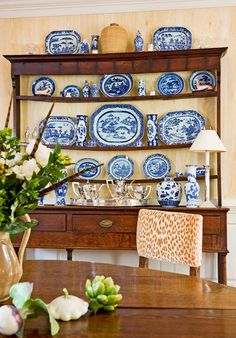 Blue-and-white porcelain in an antique sideboard.