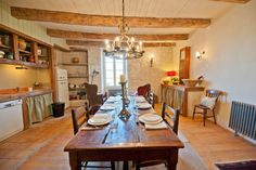 Rustic kitchen diner in French country home in South West France. The self-catering rental house has been restored to a very high standard keeping many original features. www.purefrance.com