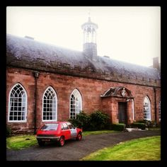 Peugeot 205 rocks Hartlebury Castle's carriage circle.
