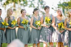 One of our favorite wedding palates Grey and yellow.  Love how simple the dresses are with the pop of yellow in the flowers makes the girls stand out just enough.  Photos by Clane Gessel Photography | #bridesmaids #weddings #yellowandgreyweddings