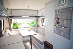 A beautyful Biod Caravan interior makeover. Dutch Vintage Camper with grey and white.