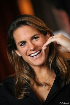 Amelie Mauresmo, Tennis player retired French - won Wimbledon - beautiful one-handed backhand