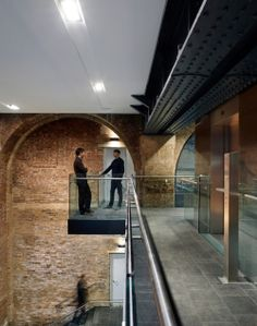 This is an example of contrast, yet it is not a contrast of colors. But instead, it is a contrast of new and old combined, which is known as justaposition in the art world. This building has older brick or stone, but also it has a very modern hallway with modern railings.