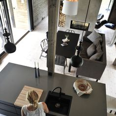 scandinavian dark grey integrated dining room and kitchen | via @rindalshytter on Instagram