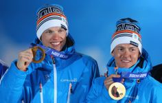 DAY 13:  Gold medalists Iivo Niskanen and Sami Jauhojaervi of Finland celebrate during the medal ceremony for the Cross Country Men's Team Sprint Classic http://sports.yahoo.com/olympics