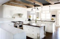 8 hot new home trends: Scaling it down. Outdoor living. White kitchen cabinets. Pet provisions. Carrara kitchen. Elevators. Fancy ceilings.