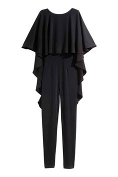Jumpsuit with a cape: Sleeveless jumpsuit in jersey with a circular cape in a crêpe weave, and a deep neckline and concealed zip at the back. The cape is divided centre back and is longer at the back.